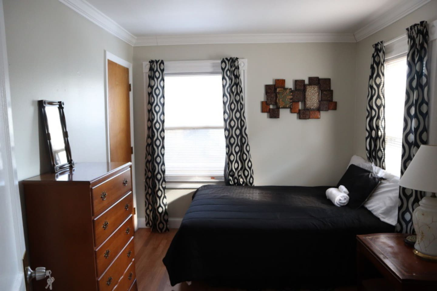 This room is located in a second-floor apartment. The apartment has recently been renovated with an eat-in kitchen and living room. The bedroom is located off the living room and has a full-size bed, closet, dresser and lounge chair.