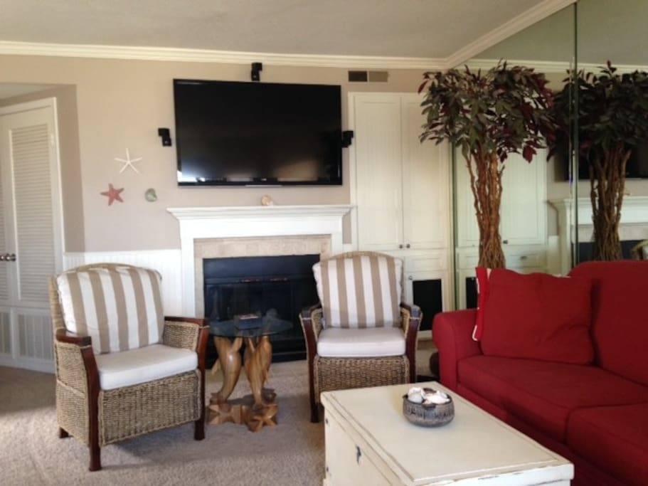 Fireplace and smart tv in living room with netflix and hulu for movie watching