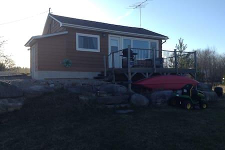 Idyllic river side cottage