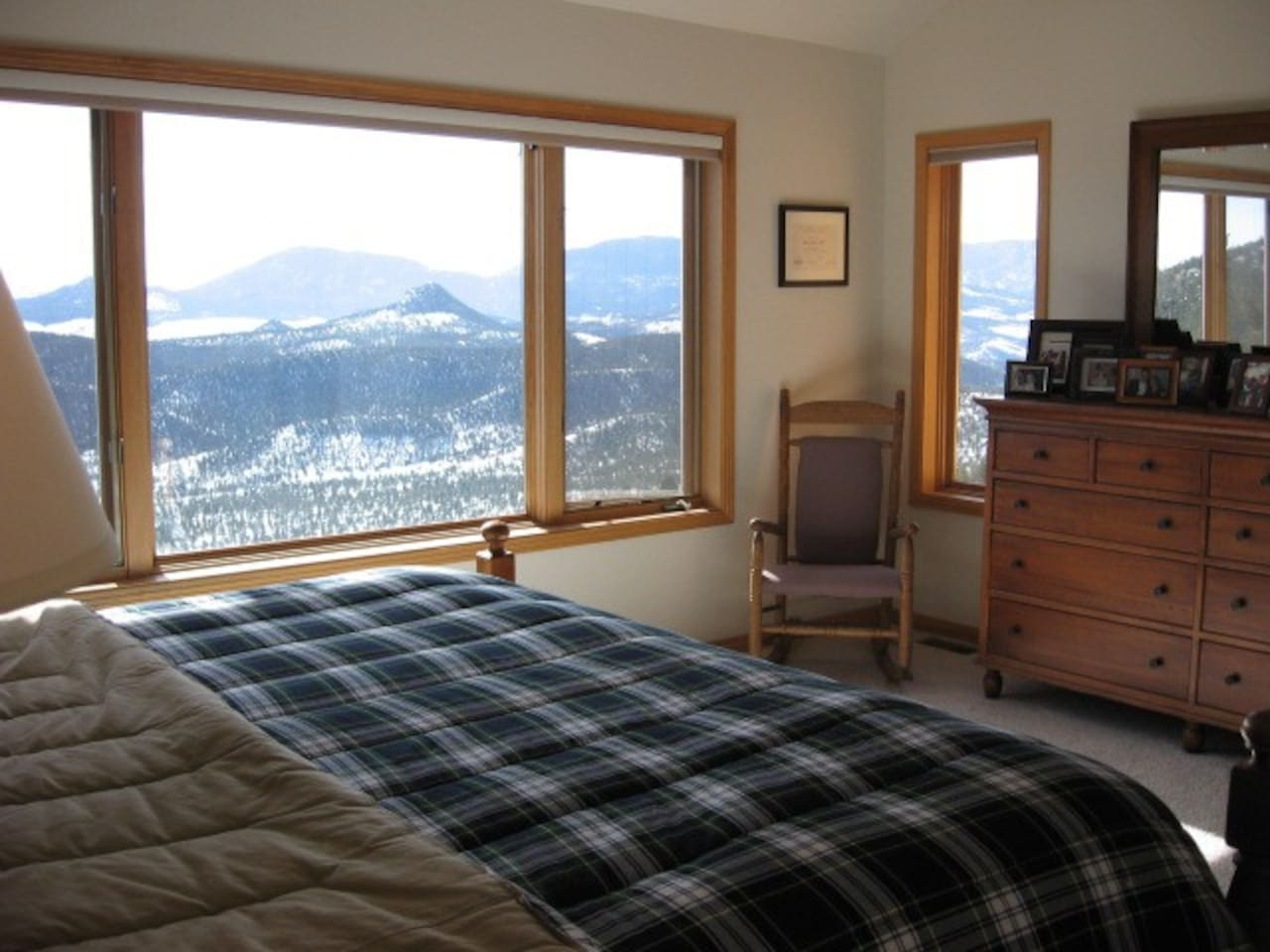 Master Bedroom with King Bed looking out at Pikes Peak