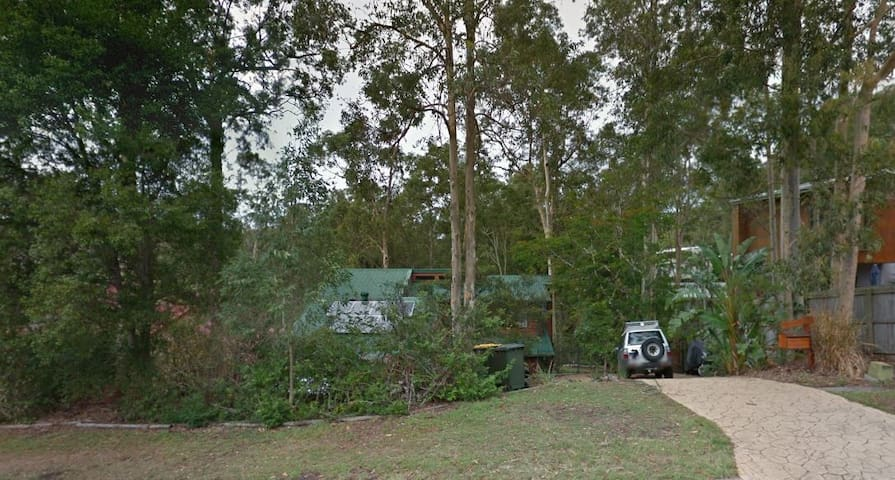 Our house is close to shops and bus but looks onto quiet bushland