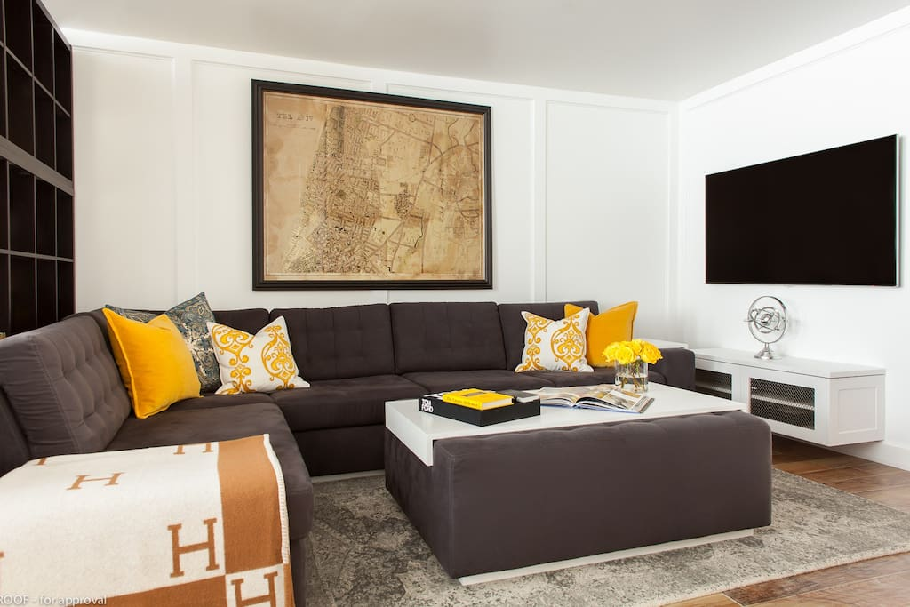 comfortable couch, ottoman and TV