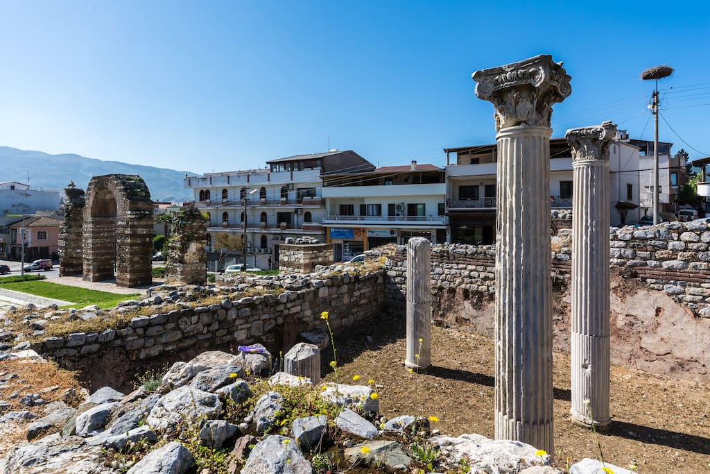View thru the ancient ruins with Selcuk Ephesus Castle View Suites in the distance.