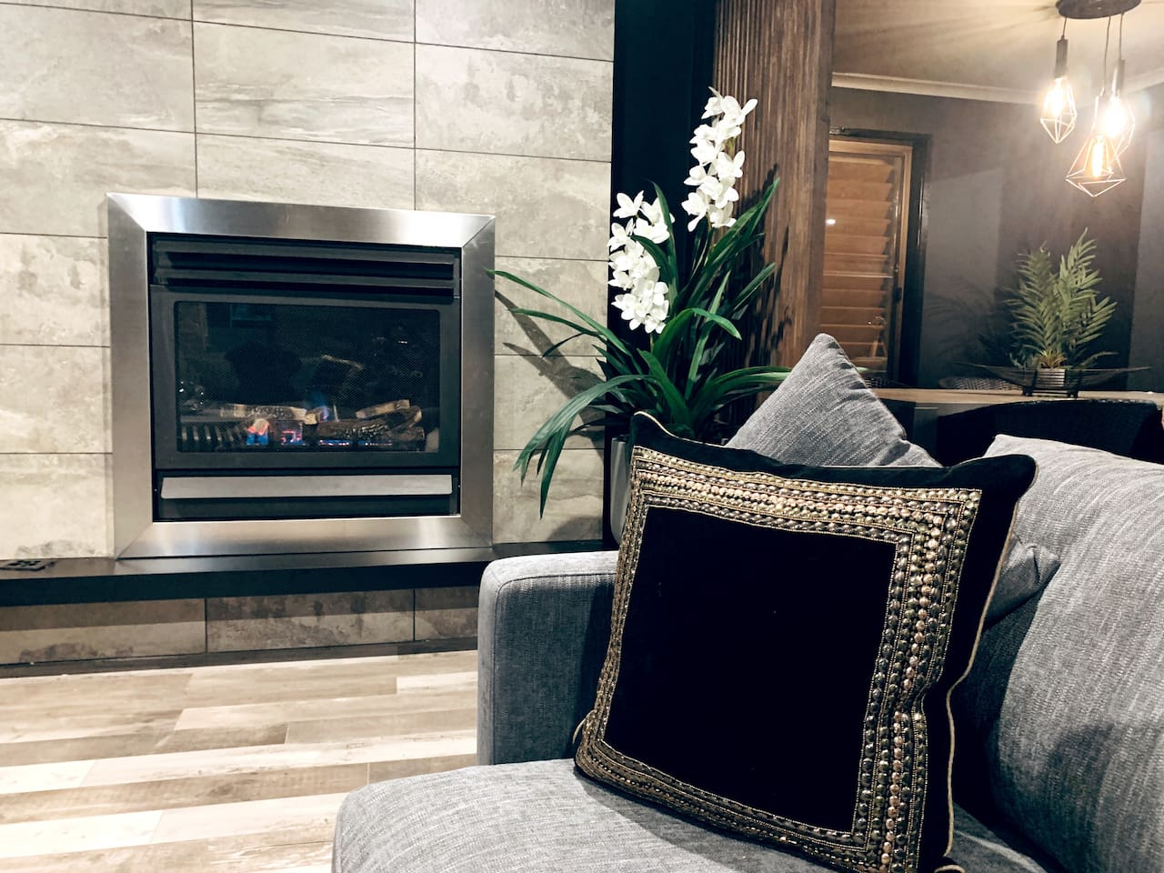The stunning lounge room has a gorgeous fireplace with a new flame log heater,to keep you warm in the chilly months.
