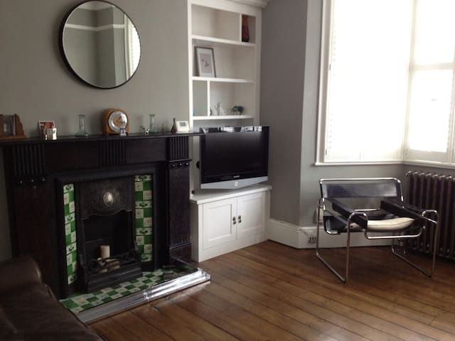 Recently refurbished sittingroom with original fireplace.