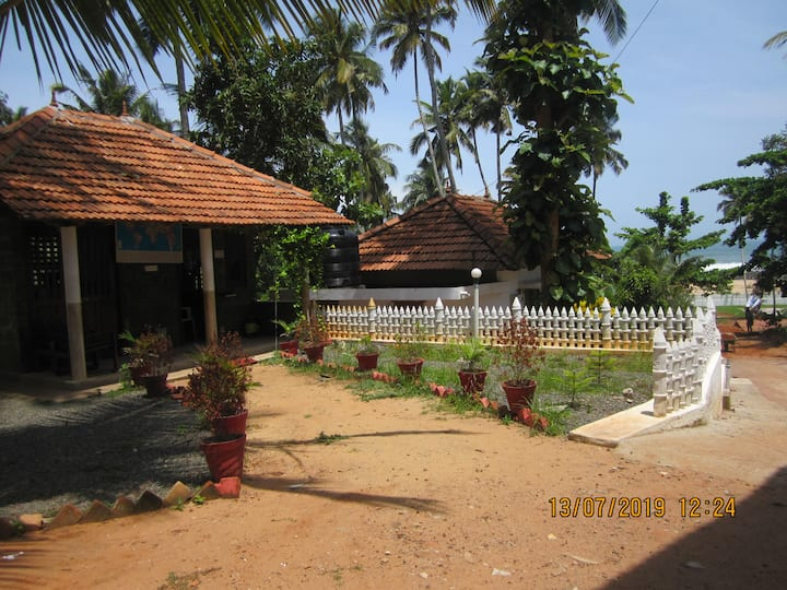 M R BEACH AND COTTAGES