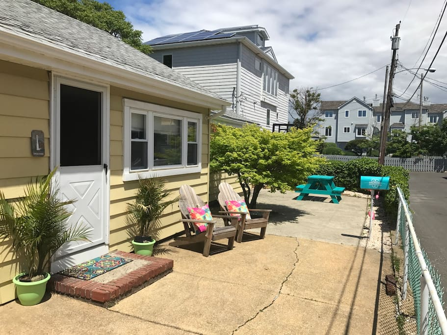 Front of house with fenced in Patio