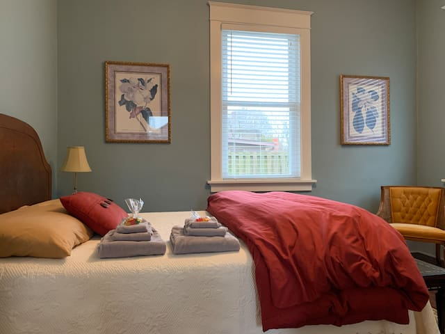 Second bedroom-full size memory foam mattress and antique bedroom set including a desk/dresser and chair