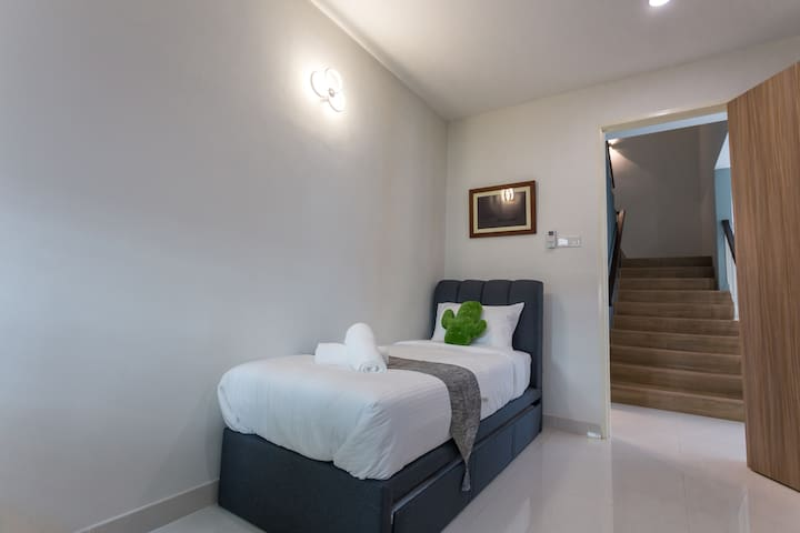 Ground Floor Guest Room with 1 single bed & 1 pullout bed with air conditioning