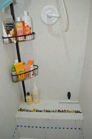 In the walk-in shower. Nice shower gels and shampoos. Bring a wash cloth- we don't own one. We do have towels!
