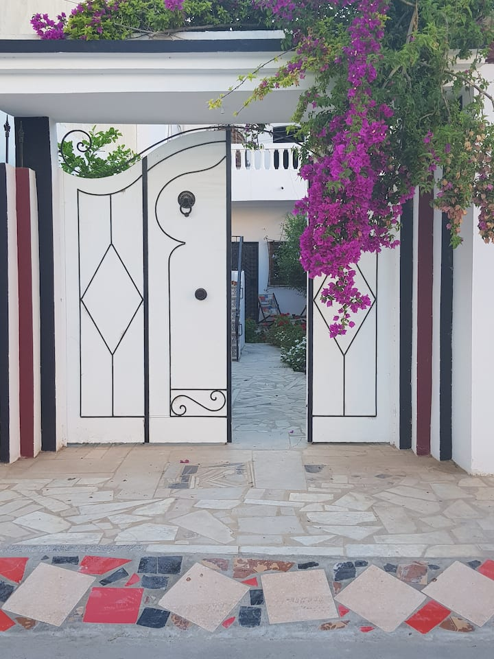 Holiday Haven with Private Garden Near Sandy Beach