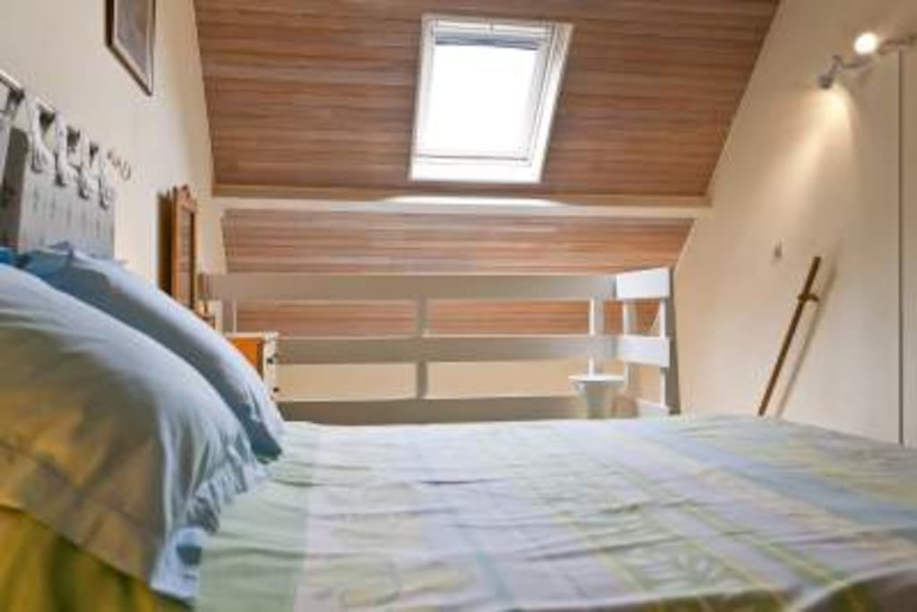 Mezzanine bedroom, light and airey. Velux with pull-down shade.