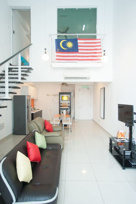 Duplex SOHO: Living Hall:- 1) 30Mbps Unlimited Wifi Internet. 2) LG Smart TV 3) 75 Channels Satellite TV 4) Aircond x 2 units 5) Sofa bed x 2nos. 6) 4 person dining table. 7) Bar counter. 8) Best swimming pool view. View distance only 30m away. 8) Aircond x 2nos.