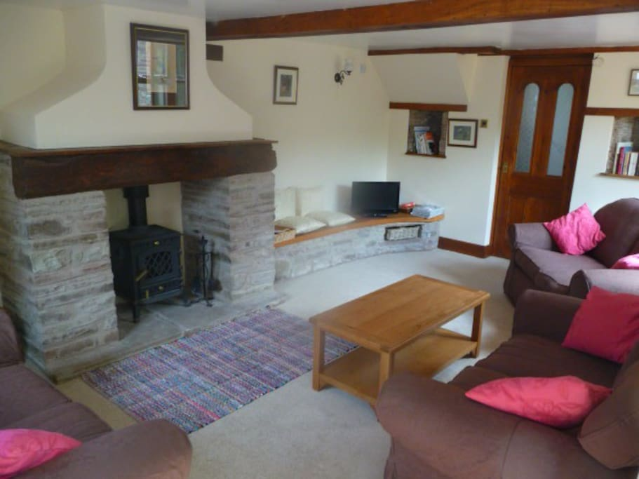 Comfy lounge with woodburner - logs included.