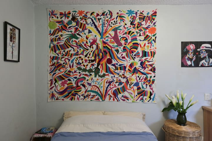 Our home is loving decorated with original artwork, local handicrafts and lots of plants! Sleeping under this incredible Otomi embroidery promises great dreams!
