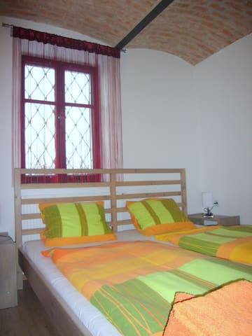 A double bed in one of the bedrooms