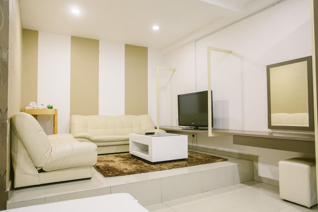 Small lounge, TV, sofas, and writing desk