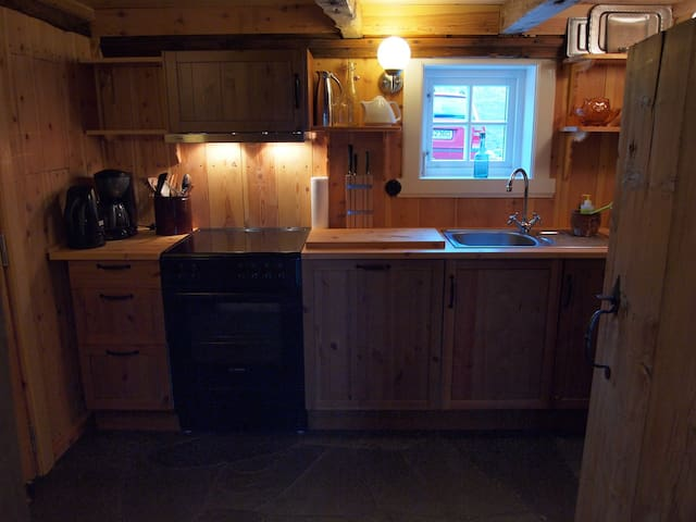 The kitchen has everything you'll need. There is heating in the floor.