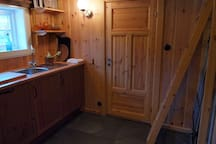 The kitchen and the ladder to the sleeping loft