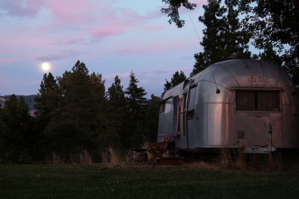 Airstream with the moon rising.