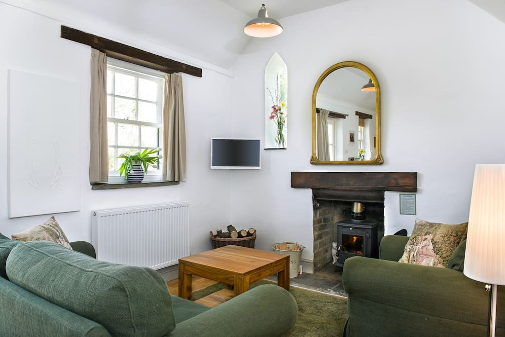 Cosy sitting room, with wood burner, TV/DVD, DVD library, free WiFi, central heating and power sockets with USB chargers for all your devices!