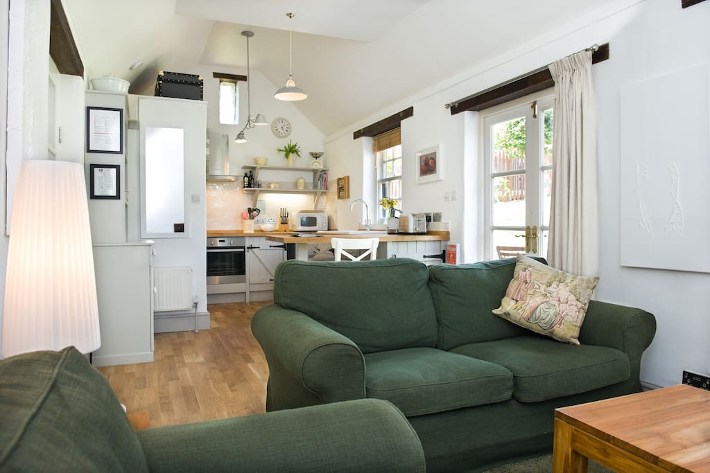 Open plan kitchen/diner and sitting room, with solid oak flooring. Cosy, sociable, warm and homely, with USB charger sockets for all your devices!