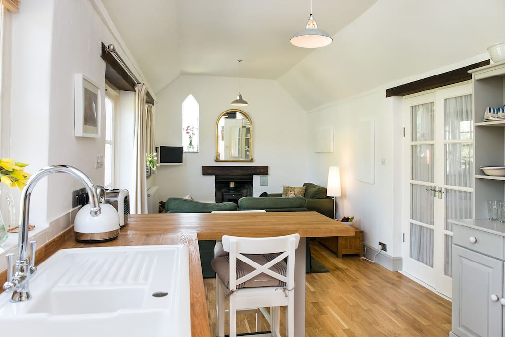 Open plan kitchen/diner and sitting room, with solid oak flooring. Cosy, sociable, warm and homely.