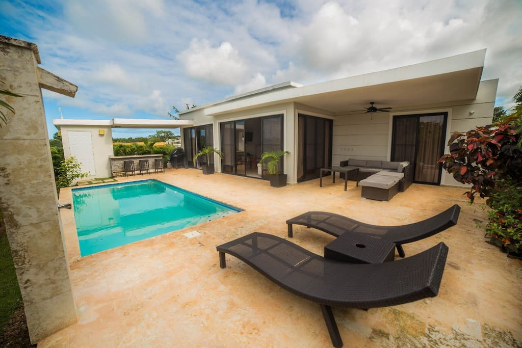 Outdoor view of villa showing each room with patio access. Pool, bar area , outdoor bathroom, and shower.