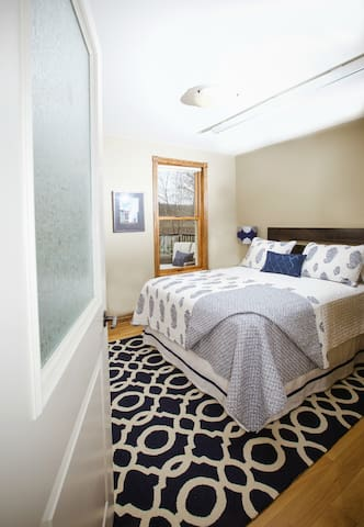 Smallest bedroom with queen bed.  Looks out over escarpment