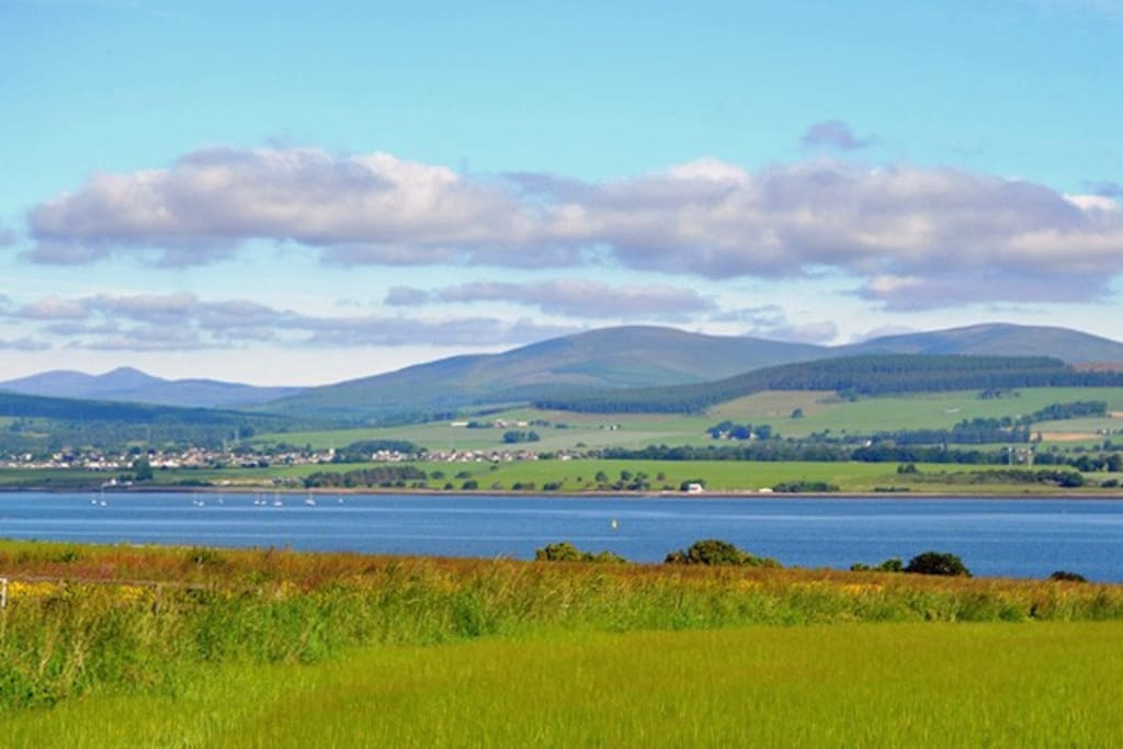 These elevated views from the house extend over barley fields, the Cromarty Firth to the hills beyond