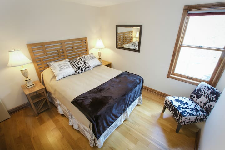 Our fourth bedroom with a queen bed; eastern exposure and a view over the Conservation area