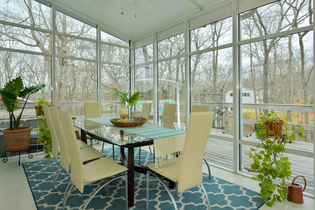 Dining area in a spacious sunroom