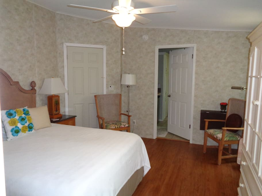 Roomy with queen size bed, two comfortable chairs, a fold away desk/table.