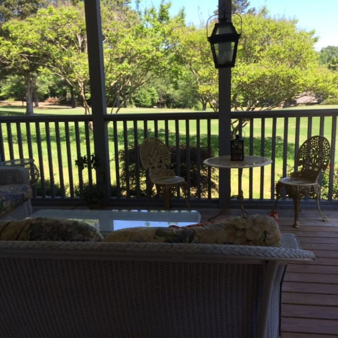 Gorgeous screened porch overlooking the 5th hole of private golf course.