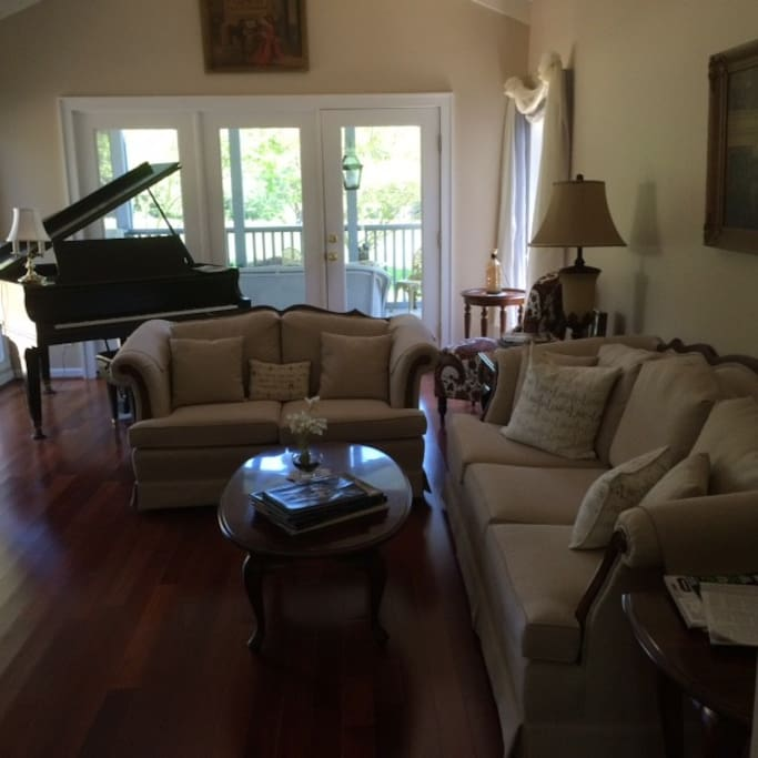 Formal living room with baby grand piano.