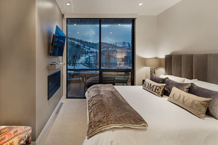 Master bedroom with awesome king size bed, large Sony 4k TV, gas fireplace, ensuite master bath, and great views.