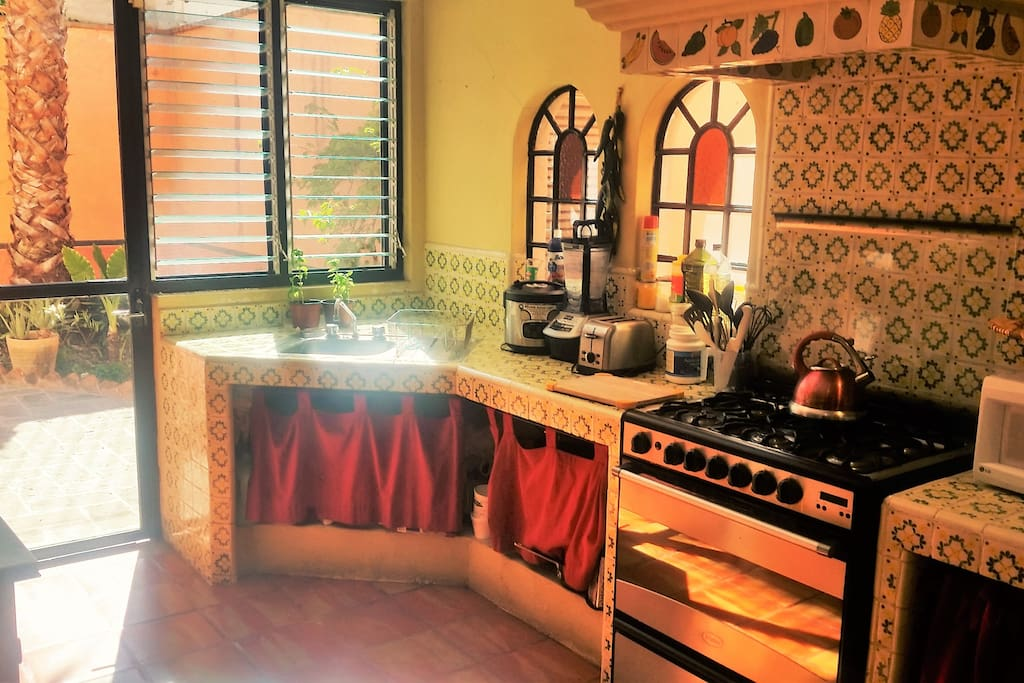 Sunny kitchen. Staying in? Cook or enjoy being served by our private chef.