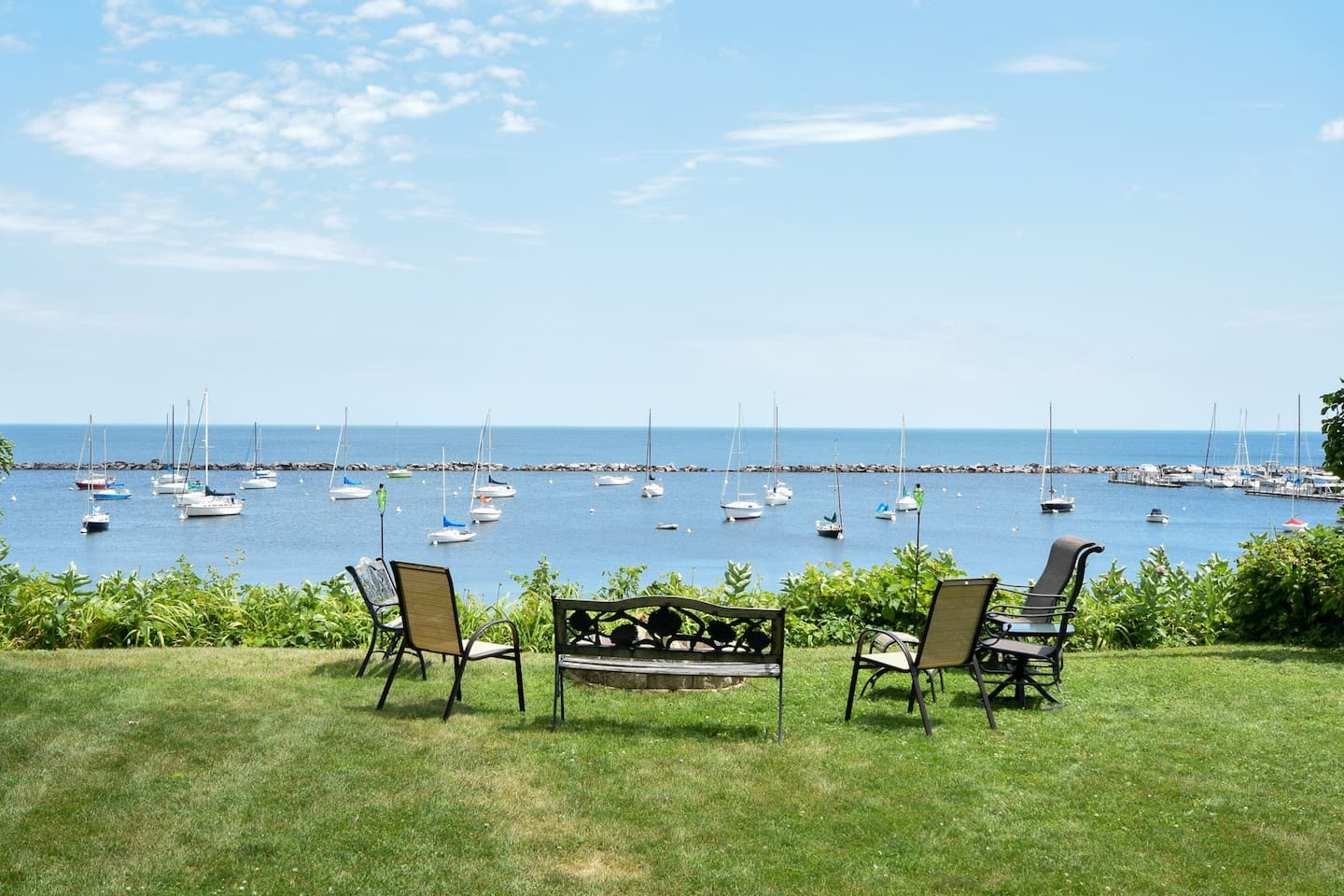 Back yard overlooking beautiful Lake Michigan.  Beautiful view of downtown and Shore Yacht Club. Firepit for cozy nights.