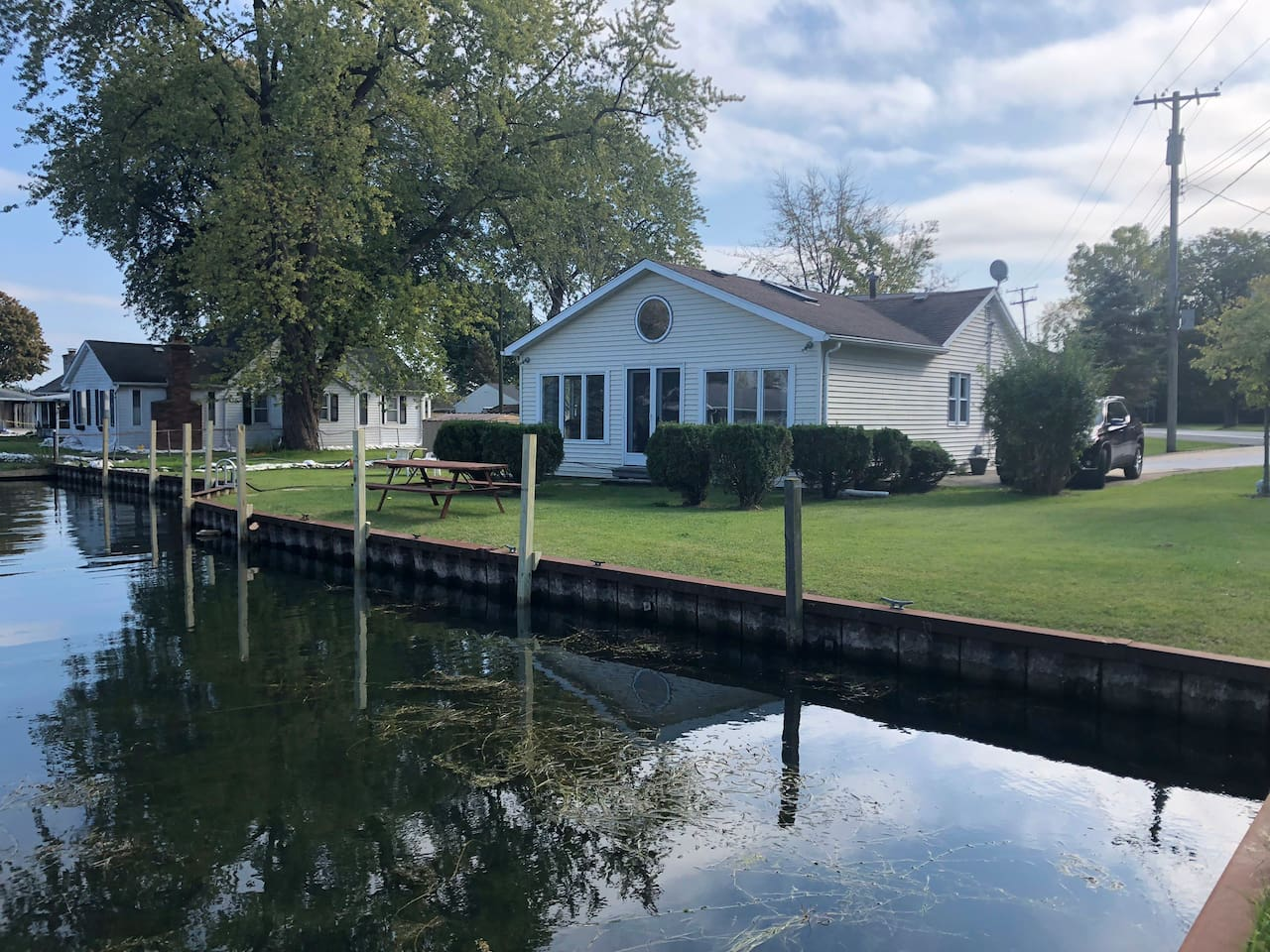 Beautiful secluded home on short canal that flows into the St Clair River.    This home will not disappoint!  Beautiful and renovated 2019 summer.     Lots of windows in great room to watch freighter, swans, and even occasionally a blue heron crane.