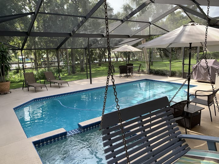 Beautiful home on large lot, pool and river w/dock