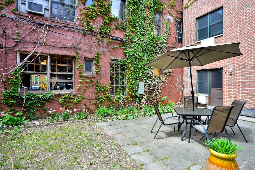 private backyard in the spring. order your coffee through the cafe window (pictured here)!