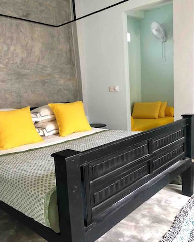 King sized bed with the sofa daybed beyond in the dressing room that converts to a full single bed. Ideal for a small family traveling with a child.