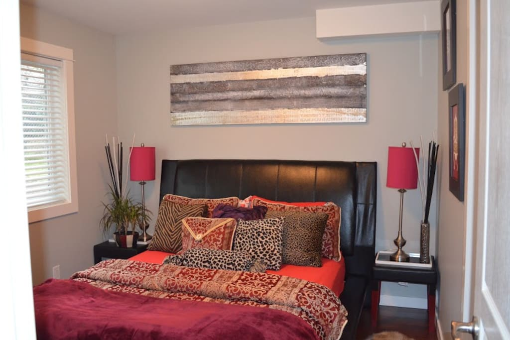 Suite bedroom with queen size leatherette bad