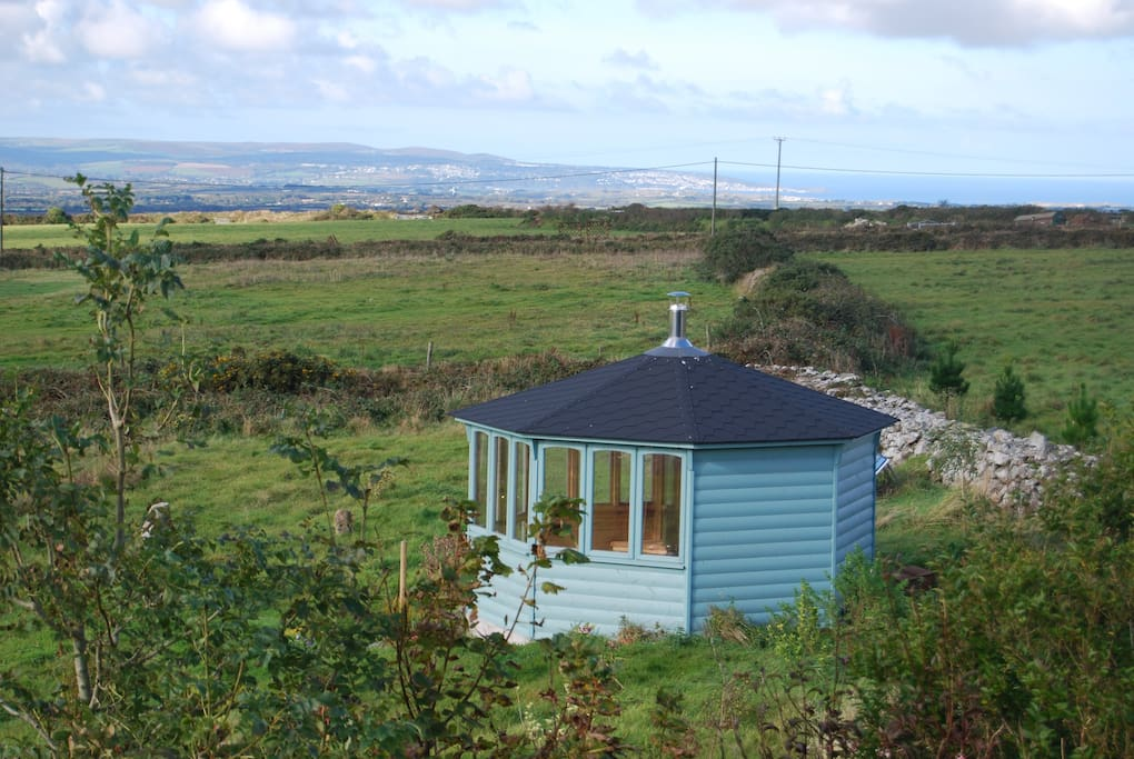 The summer house looks over to St Ives with wood burner for romantic evenings.