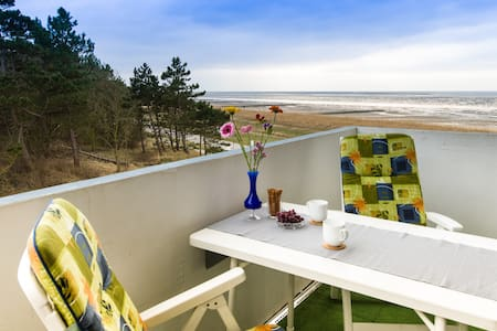 Seaside flat with a roofed beach chair