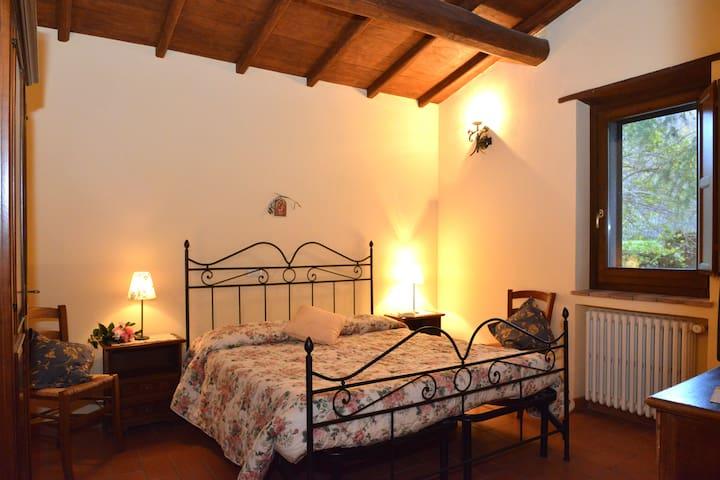 Camera da letto appartamento Melograno