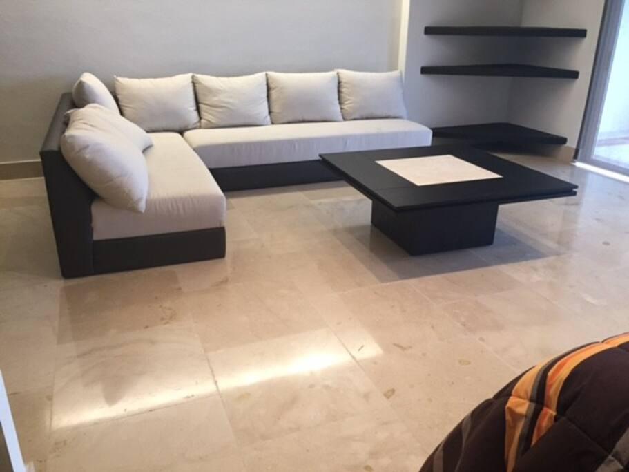 sala con sofa camas