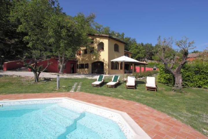 Holiday apartment in a beautiful villa surrounded by idyllic garden property, shared pool and superb views of the valley