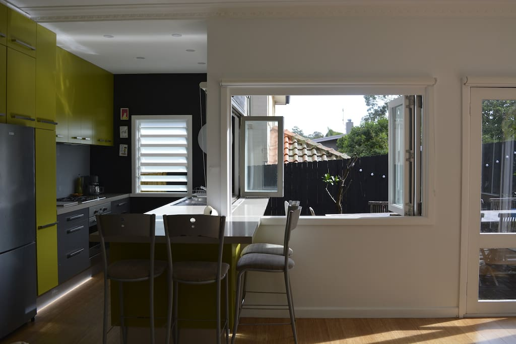 Kitchen with bi-fold windows to outside dining area. Adjoins main family room. Looks onto North facing backyard.