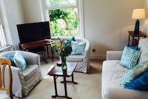 Sitting room with sofa bed, double aspect views and Virgin cable TV / fibre internet